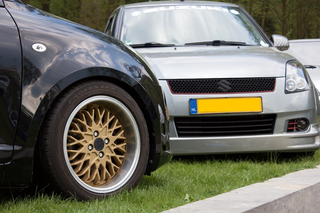 Closeup of golden Abarth wheel on Suzuki Swift